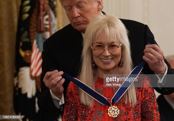 S President Donald Trump presents the Presidential Medal of Freedom to physician Miriam Adelson wife of Sheldon Adelson during an East Room ceremony...