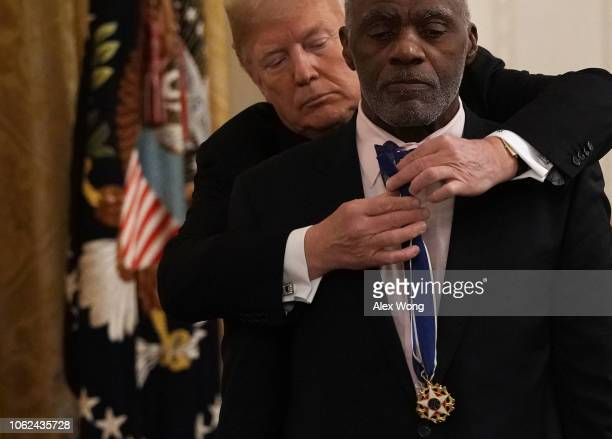 S President Donald Trump presents the Presidential Medal of Freedom to former Minnesota Supreme Court Justice and college football player Alan Page...