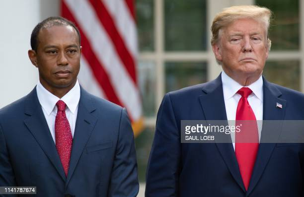 US President Donald Trump presents the Presidential Medal of Freedom to golfer Tiger Woods during a ceremony in the Rose Garden of the White House in...