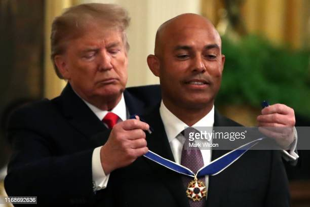 President Donald Trump presents the Presidential Medal of Freedom to former New York Yankees player Mariano Rivera in the East Room of the White...