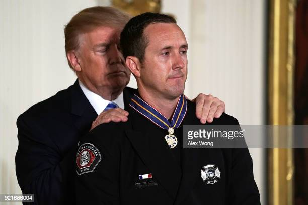 S President Donald Trump presents the Public Safety Medal of Valor to Engineer Stephen Gunn of Peoria FireMedical Department in Arizona during an...