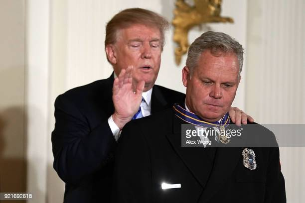 S President Donald Trump presents the Public Safety Medal of Valor to firefighter/Harbor Patrol Officer David Poirier of Redondo Beach Fire...