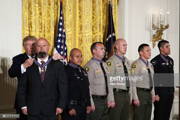 US President Donald Trump presents the Public Safety Medal of Valor to District Attorney Investigator Chad Johnson San Bernardino County District...