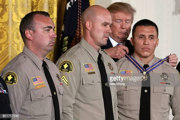 S President Donald Trump presents the Public Safety Medal of Valor to Deputy Shaun Wallen San Bernardino County Sheriff's Department CA Detective...