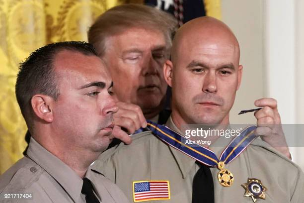 S President Donald Trump presents the Public Safety Medal of Valor to Deputy Shaun Wallen San Bernardino County Sheriff's Department CA and Detective...