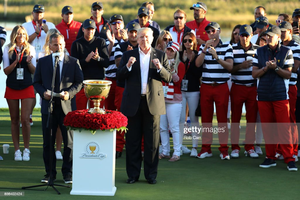 U.S. President Donald Trump presents the U.S. Team with the trophy after they defeated the International Team 19 to 11 in the Presidents Cup at Liberty National Golf Club on October 1, 2017 in Jersey City, New Jersey.