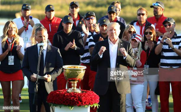 S President Donald Trump presents the US Team with the trophy after they defeated the International Team 19 to 11 in the Presidents Cup at Liberty...