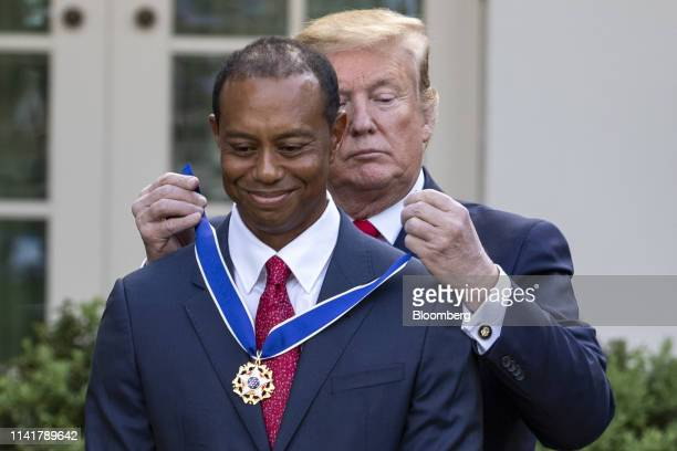 US President Donald Trump presents Tiger Woods professional golfer and cofounder of the Tiger Woods Foundation with a Presidential Medal of Freedom...