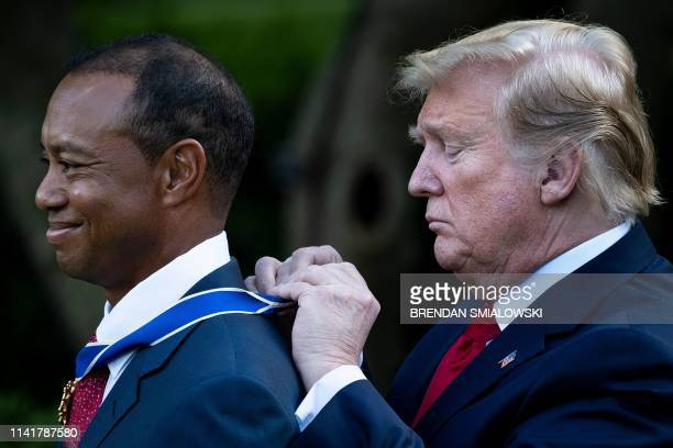 President Donald Trump presents US golfer Tiger Woods with the Presidential Medal of Freedom during a ceremony in the Rose Garden of the White House...