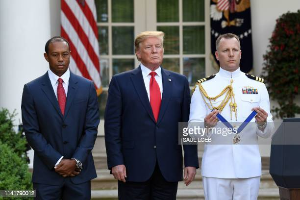 US President Donald Trump presents US golfer Tiger Woods with the Presidential Medal of Freedom during a ceremony in the Rose Garden of the White...