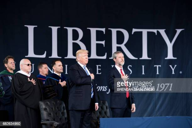 US President Donald Trump President of Liberty University Jerry Falwell and others participate in the Pledge of Allegiance during Liberty...