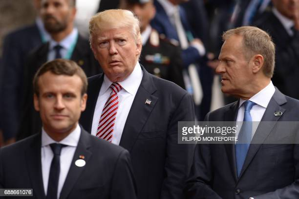 President Donald Trump President of the European Commission JeanClaude Juncker and French President Emmanuel Macron walk to the Hotel San Domenico...