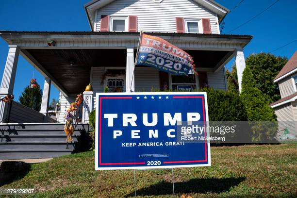 President Donald Trump presidential campaign sign is staked on the front lawn of a residential house October 9, 2020 in Throop, Pennsylvania. The...