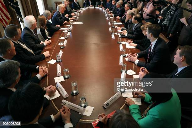 President Donald Trump presides over a meeting about immigration with Republican and Democrat members of Congress in the Cabinet Room at the White...