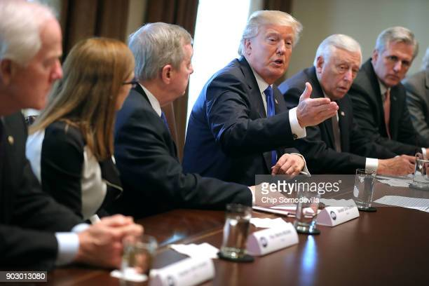 S President Donald Trump presides over a meeting about immigration with Republican and Democrat members of Congress including Senate Majority Whip...