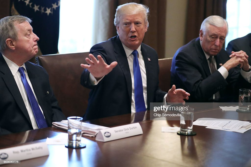 U.S. President Donald Trump (C) presides over a meeting about immigration with Republican and Democrat members of Congress, including Senate Minority Whip Richard Durbin (D-IL) (L) and House Minority Whip Steny Hoyer (D-MD) in the Cabinet Room at the White House January 9, 2018 in Washington, DC. In addition to seeking bipartisan solutions to immigration reform, Trump advocated for the reintroduction of earmarks as a way to break the legislative stalemate in Congress.