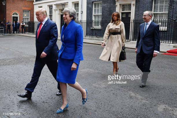 President Donald Trump Prime Minister Theresa May her husband Philip May and First Lady Melania Trump leave 10 Downing Street during the second day...