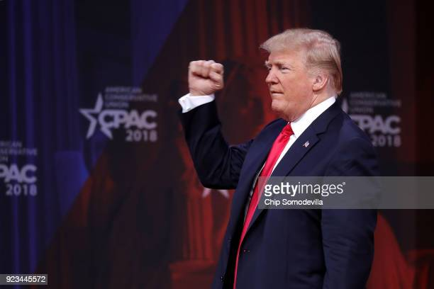 S President Donald Trump pumps his fist after addressing the Conservative Political Action Conference at the Gaylord National Resort and Convention...