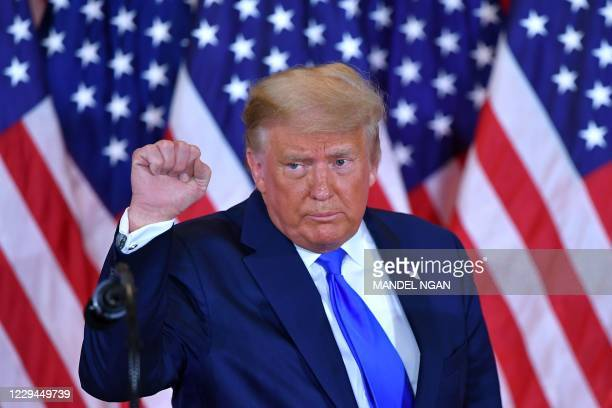 President Donald Trump pumps his fist after speaking during election night in the East Room of the White House in Washington, DC, early on November...