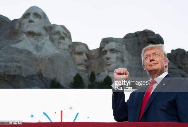 US President Donald Trump pumps his fist as he arrives for the Independence Day events at Mount Rushmore National Memorial in Keystone South Dakota...