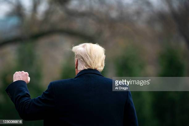 President Donald Trump pumps his fist as he departs on the South Lawn of the White House, on December 12, 2020 in Washington, DC. Trump is traveling...