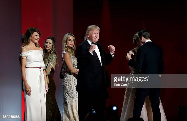 President Donald Trump pumps his fist as his family dances at the Liberty Inaugural Ball on January 20 2017 in Washington DC The Liberty Ball is the...