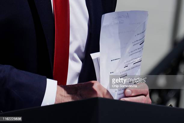 S President Donald Trump puts away his notes after addressing his Made In America product showcase at the White House July 15 2019 in Washington DC...