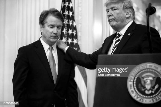 S President Donald Trump puts his hand on Supreme Court Associate Justice Brett Kavanaugh's shoulder during his ceremonial swearing in in the East...