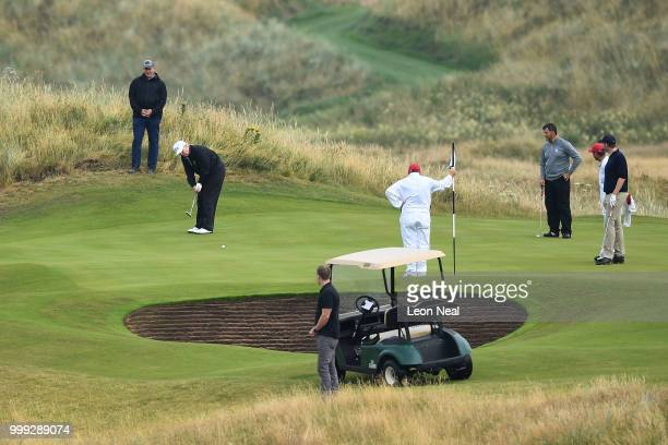 S President Donald Trump putts whilst playing a round of golf at Trump Turnberry Luxury Collection Resort during the US President's first official...