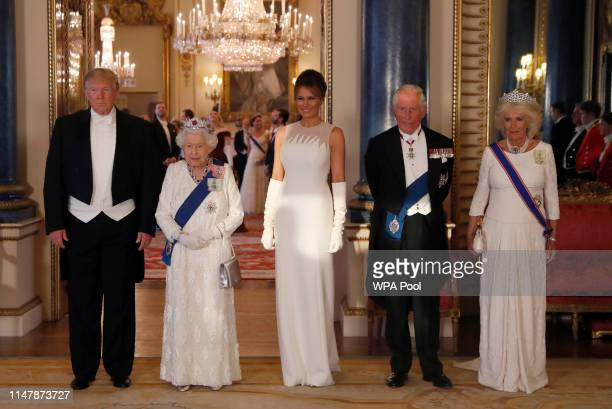 President Donald Trump, Queen Elizabeth II, First Lady Melania Trump, Prince Charles Prince of Wales and Camilla Duchess of Cornwall pose for a...