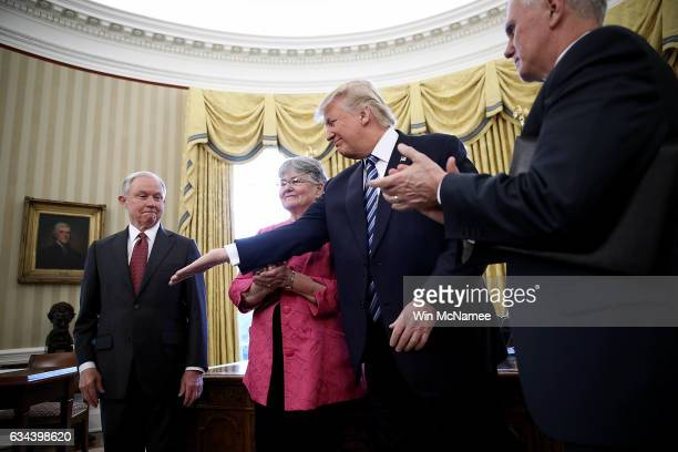 S President Donald Trump reaches to shake the hand of Jeff Sessions after Sessions was sworn in as the new US Attorney General by US Vice President...