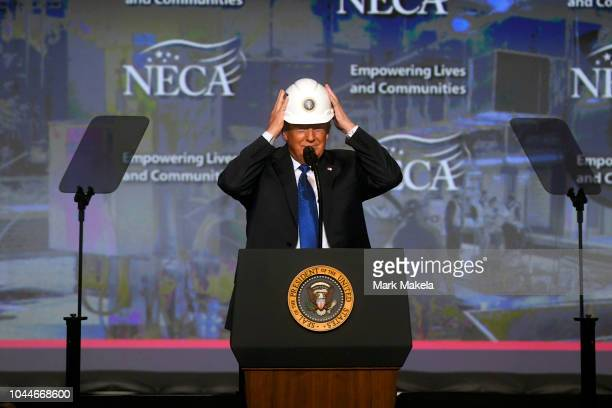 S President Donald Trump reacts after putting on a hard hat as he addresses the National Electrical Contractors Convention on October 2 2018 in...