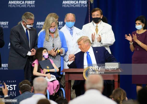 S President Donald Trump reacts after signing an executive order following his remarks on his healthcare policies on September 24 2020 in Charlotte...