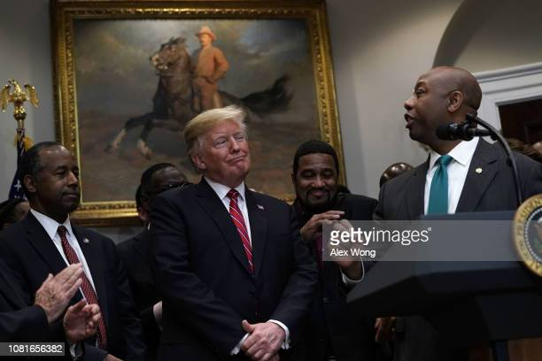 S President Donald Trump reacts as Sen Tim Scott praises him as Secretary of Housing and Urban Development Secretary Ben Carson looks on during a...