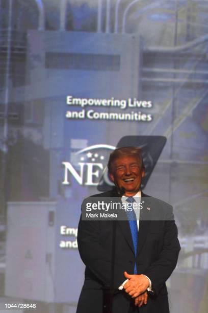 President Donald Trump reacts during a speech behind a teleprompter during the National Electrical Contractors Convention on October 2, 2018 in...
