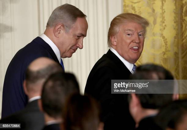 S President Donald Trump reacts to a reporter shouting a question as he departs with Israel Prime Minister Benjamin Netanyahu following a joint news...
