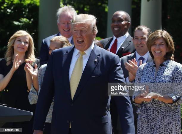 S President Donald Trump reacts to having to having the song Happy Birthday sung to him before speaking about expanding healthcare coverage for small...