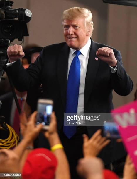 S President Donald Trump reacts to the crowd after being interviewed by Fox News Channel and radio talk show host Sean Hannity before a campaign...