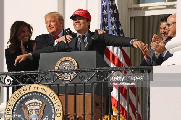 S President Donald Trump reacts to Washington National catcher Kurt Suzuki wearing a 'Make America Great Again' cap during a celebration of the 2019...