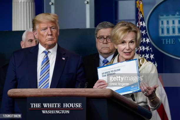 S President Donald Trump reacts to White House coronavirus response coordinator Deborah Birx as she speaks at the daily coronavirus briefing at the...