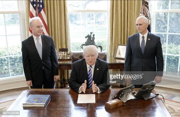 S President Donald Trump reacts with HHS Secretary Tom Price and Vice President Mike Pence after Republicans abruptly pulled their health care bill...