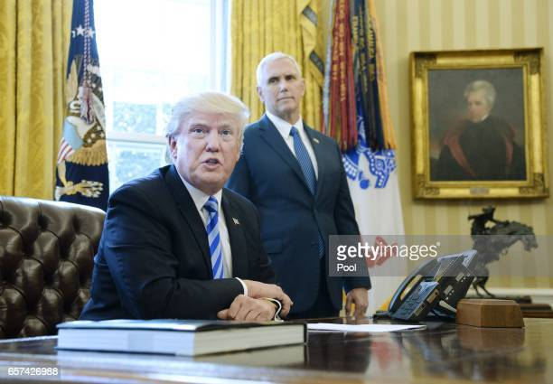 S President Donald Trump reacts with Vice President Mike Pence after Republicans abruptly pulled their health care bill from the House floor in the...