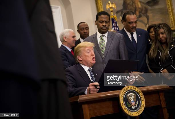 US President Donald Trump reads a proclamation for Martin Luther King Jr Day in the Roosevelt Room of the White House in Washington DC US on Friday...