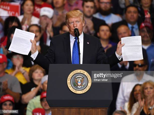 S President Donald Trump reads from what he said was a list of his administation's accomplishments during a campaign rally at the Las Vegas...