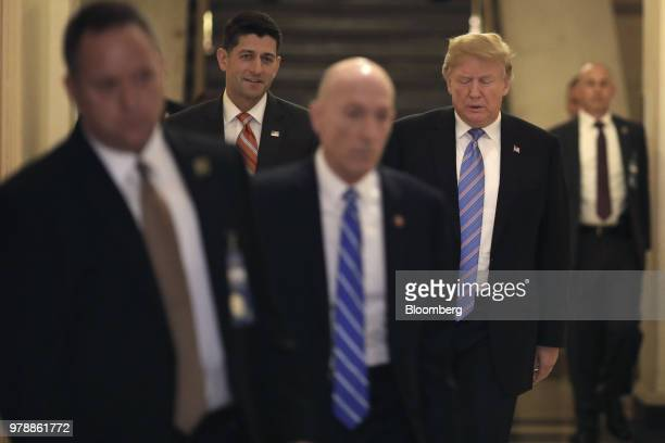 US President Donald Trump rear right and US House Speaker Paul Ryan a Republican from Wisconsin rear left walk to a House Republican conference...