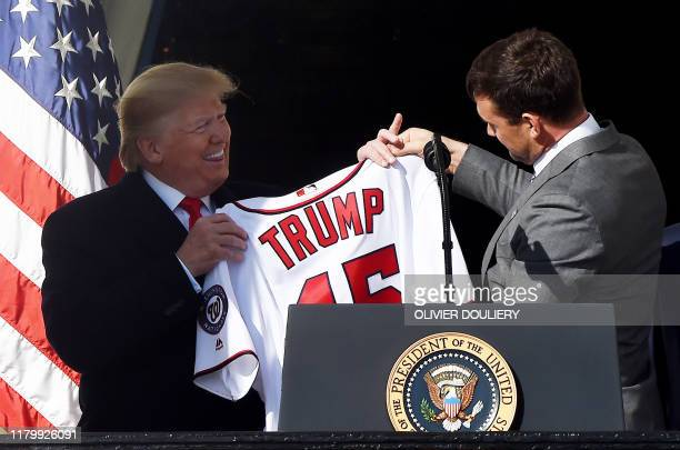 US President Donald Trump received a jersey from Nationals player Ryan Zimmerman during a ceremony to welcome the 2019 World Series Champions the...