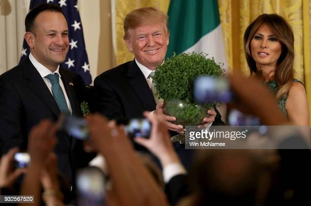 S President Donald Trump receives a bowl of shamrocks from Irish Prime MinisterÊLeo Varadkar at the White House with US first lady Melania Trump...