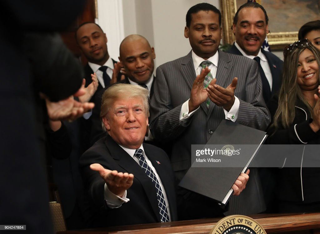 U.S. President Donald Trump receives applause from members of the African American community after signing a proclamation to honor Martin Luther King, Jr. day, in the Roosevelt Room at the White House, on January 12, 2018 in Washington, DC. Monday January 16 is a federal holiday to honor Dr. King and his legacy.