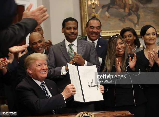 S President Donald Trump receives applause from members of the African American community after signing a proclamation to honor Martin Luther King Jr...
