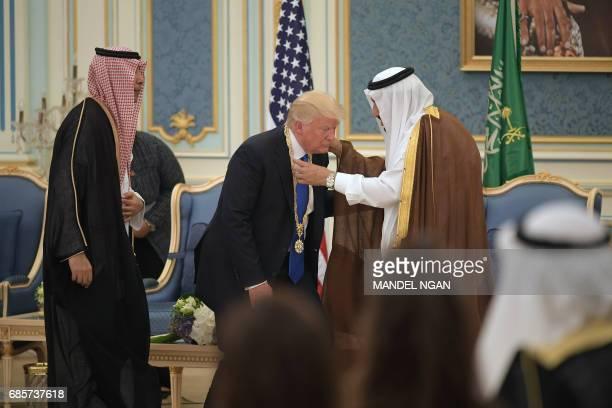 US President Donald Trump receives the Order of Abdulaziz alSaud medal from Saudi Arabia's King Salman bin Abdulaziz alSaud at the Saudi Royal Court...